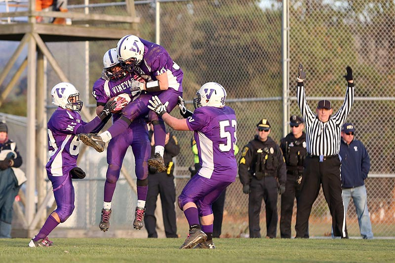 From left, Paul Mayhew, Jacob Cardoza, Austin Chandler and Andy DiMattia celebrate the third MV touchdown, putting the game out of reach for Nantucket.
