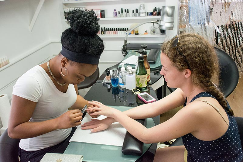 photo essay iris albert prepares for the prom the martha s  sammoy duncan of pure touch salon in edgartown helps iris decide on what manicure to get for prom photo by siobhan beasley
