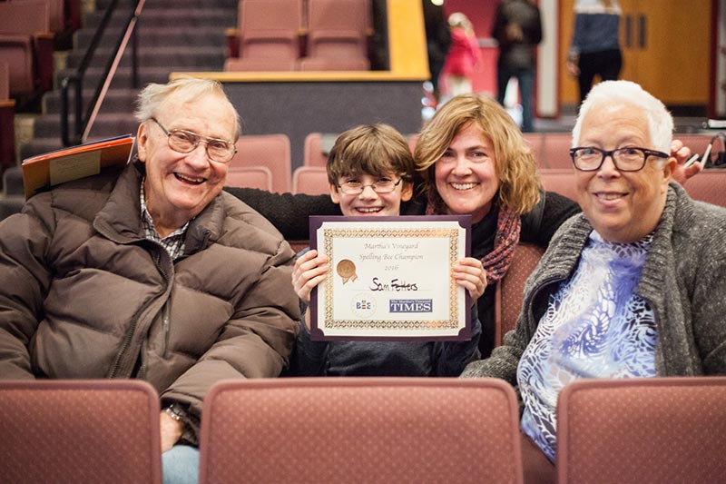 Winning Speller Sam Fetters Holds His Award With Grandparents John And Kay  Leaird And Mother Kim Leaird.   Photo By Sam Moore