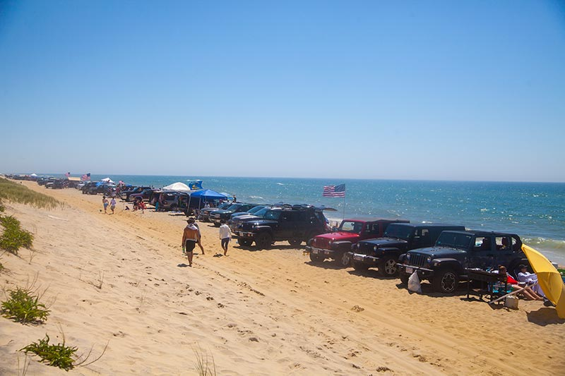 A Line Of Vehicles Stretched Down Crowded Norton Point Beach On Monday Morning Sam Moore