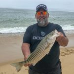 Jamie Golden with a nice striped bass.